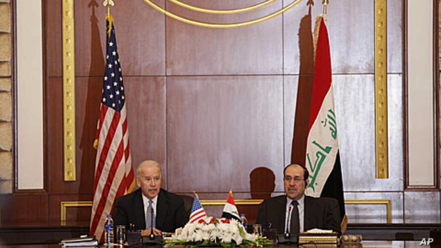 U.S. Vice President Joseph Biden, left, and Iraqi Prime Minister Nouri al-Maliki, right, hold a joint news conference in Baghdad, Iraq, Nov. 30, 2011.
