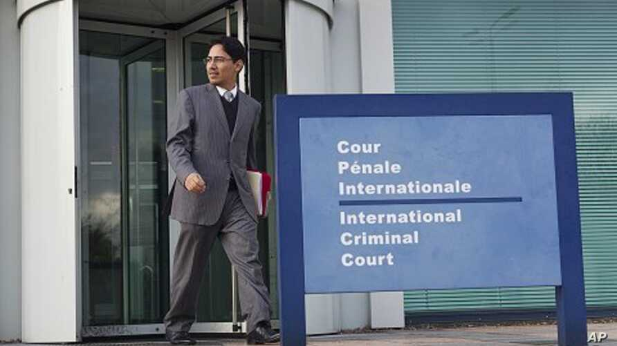 Netzai Sandoval, a Mexican human rights lawyer, leaves the ICC building after filing a complaint with the International Criminal Court in The Hague, November 25, 2011.