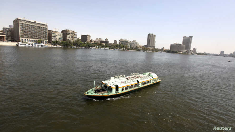 A boat cruises in the Egyptian Nile River in Cairo, May 28, 2013.