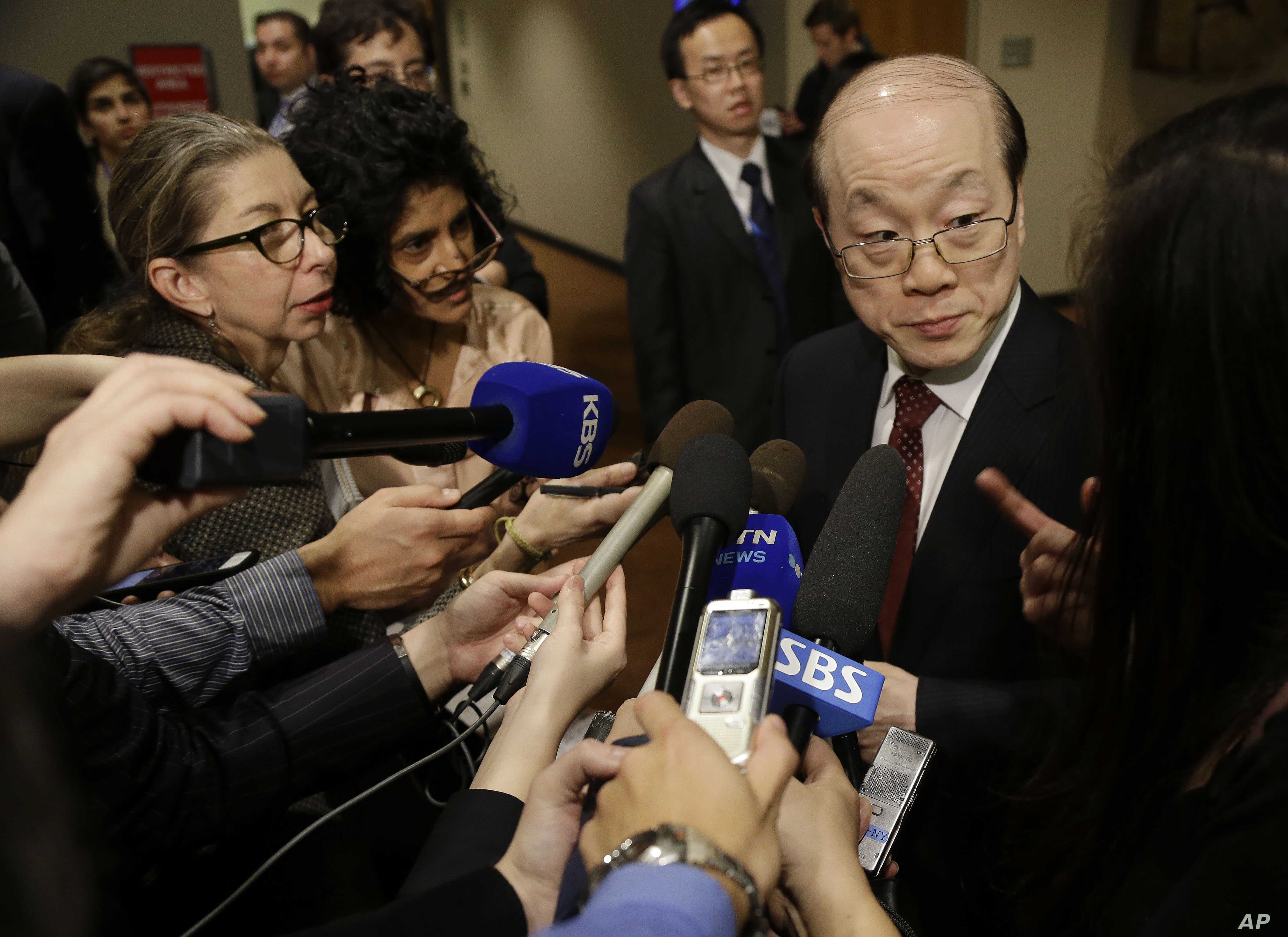 FILE - China's Ambassador to the U.N. Liu Jieyi, right, takes questions from the media during a break in United Nations Security Council consultations.