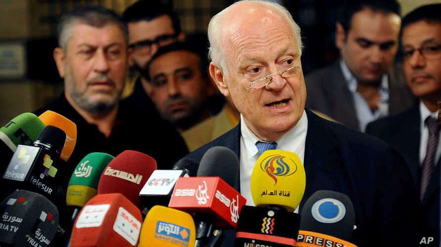 In this photo released by the Syrian official news agency SANA, United Nations special envoy to Syria Staffan de Mistura, speaks during a press conference in Damascus, Syria, Nov. 11, 2014.