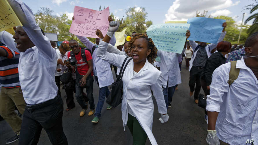 FILE - Kenyan nurses and other health-workers demonstrate over low pay at Uhuru Park in downtown Nairobi, Dec. 8, 2016.