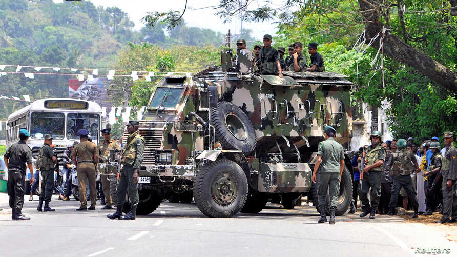 Sri Lanka's army soldiers stand guard a road after a clash between two communities in Digana, central district of Kandy, Sri Lanka, March 6, 2018.