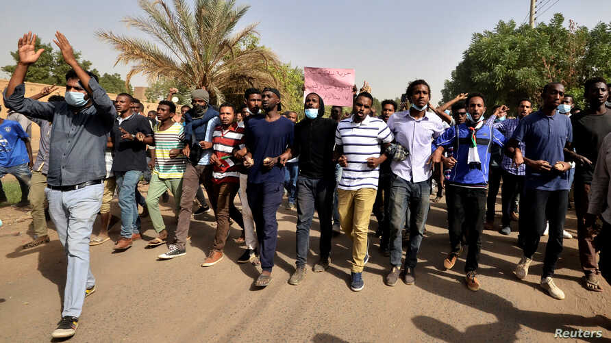 Sudanese demonstrators chant slogans as they participate in anti-government protests in Khartoum, Sudan, Jan. 17, 2019.