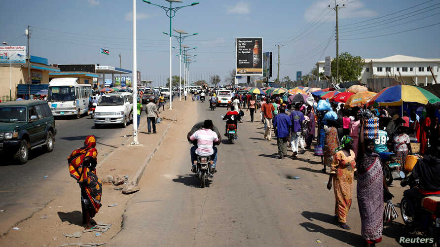 FILE - People walk along a street in Juba, South Sudan, Dec. 21, 2013. Amid a crime wave, residents are paying police unofficially to patrol their neighborhoods.