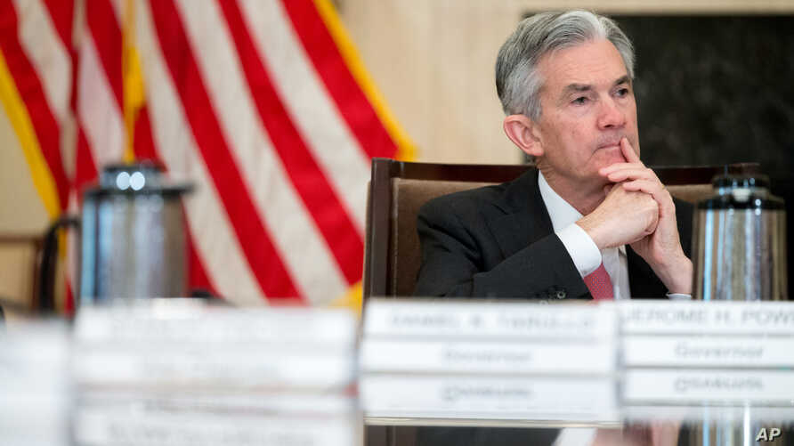 FILE - Gov. Jerome Powell attends a Board of Governors meeting at the Marriner S. Eccles Federal Reserve Board Building in Washington, Nov. 30, 2015.