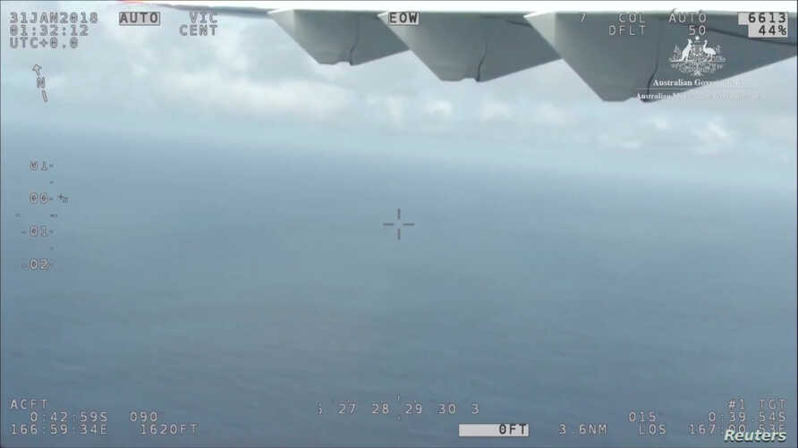 AMSA's (Australia Maritime Safety Authority) Challenger aircraft is seen in the air, supporting the international search effort for survivors from Kiribati ferry Butiraoi, near Kiribati, Jan. 31, 2018 in this still image taken from a video obtained o