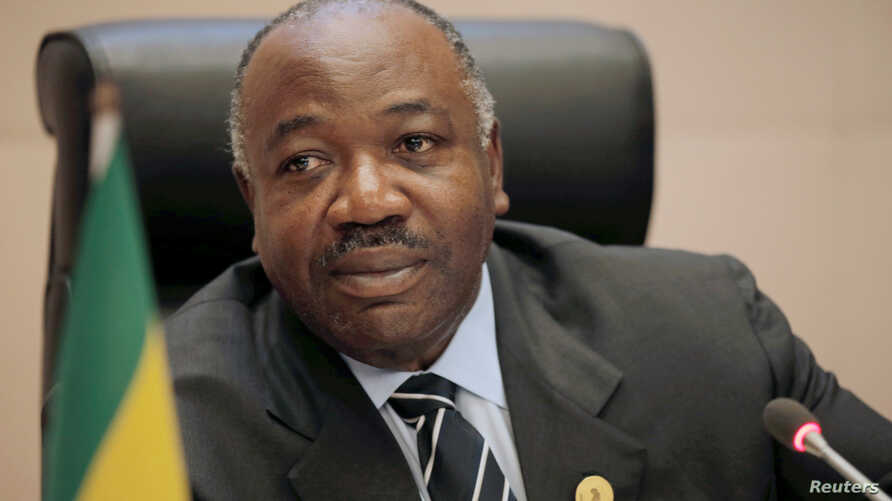FILE - Gabon's President Ali Bongo Ondimba addresses a meeting on climate change at the 30th Ordinary Session of the Assembly of the Heads of State and the Government of the African Union in Addis Ababa, Ethiopia, Jan. 29, 2018.
