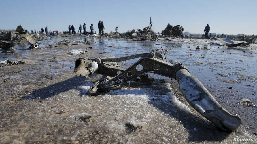 Emergencies Ministry members work at the crash site of a Boeing 737-800 Flight FZ981 operated by Dubai-based budget carrier FlyDubai, at the airport of Rostov-On-Don, Russia, March 20, 2016.