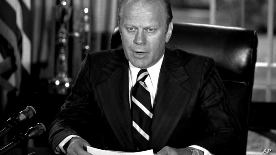 "FILE - President Gerald Ford announces he has granted former President Richard M. Nixon ""a full, free and absolute pardon"" for all ""offenses against the United States"" during the period of his presidency in this Sept. 8, 1974 file photo."