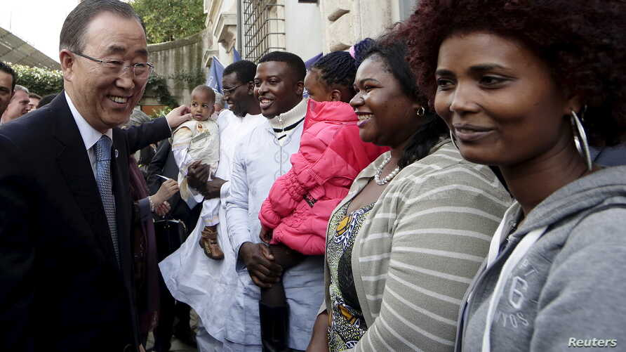 United Nations Secretary-General Ban Ki-moon (L) is greeted as he meets refugees and asylum-seekers during his visit to the Saint Egidio Catholic in Rome, Oct. 17, 2015.