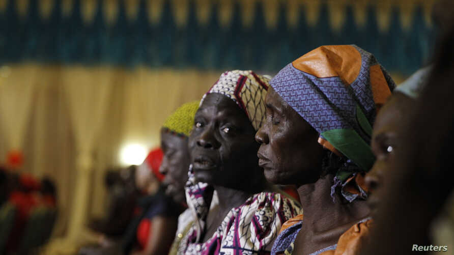 Parents of the Chibok girls attend a meeting with Nigeria's President Muhammadu Buhari at the presidential villa in Abuja, Nigeria, Jan. 14, 2016.