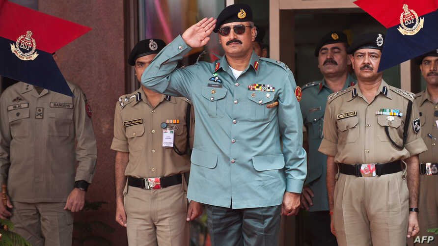 FILE - Then-Director General of Pakistani Rangers (Sindh) Karachi, Major General Rizwan Akhtar (C) salutes during a guard of honor prior to a meeting at India's Border Security Force (BSF) headquarters in New Delhi, July 2, 2012.