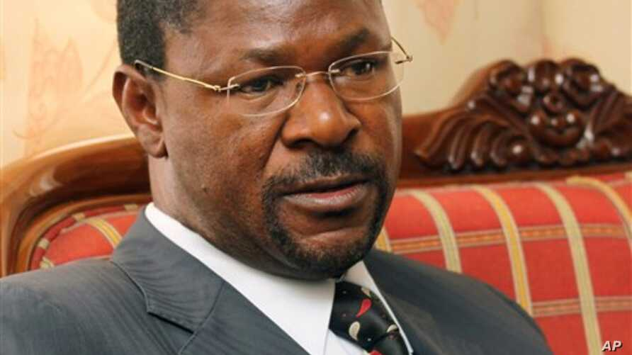 FILE-In this file photo taken Thursday, July 8, 2010 Kenyan Foreign Affairs Minister Moses Wetangula is seen during an interview with The Associated Press in Nairobi, Kenya. Wetangula quit his Cabinet post on Wednesday, Oct. 27, 2010 to allow investi
