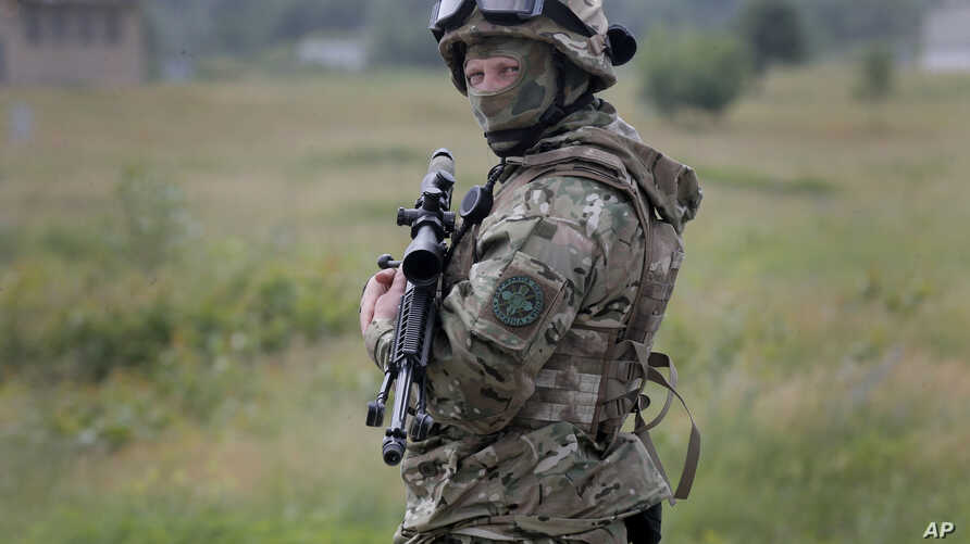 FILE - A Ukrainian soldier stands during training in a landfill at Chuguev, Ukraine, June 4, 2014.