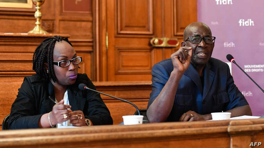 President of the Association for the Protection of Human Rights and Detained Persons Pierre Claver (R) and Burundian journalist Elyse Ngabire (L) speak during a press conference organized by the International Federation for Human Rights (FIDH) about