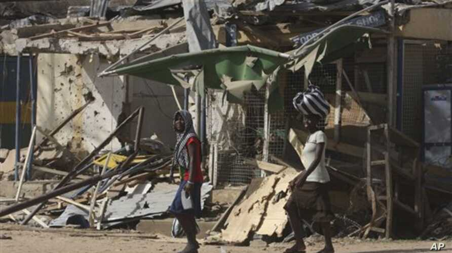 Police say Boko Haram militants staged attack in Kano, Nigeria Jan 24, 2011 which left this market in ruins and left at lead 185 people dead