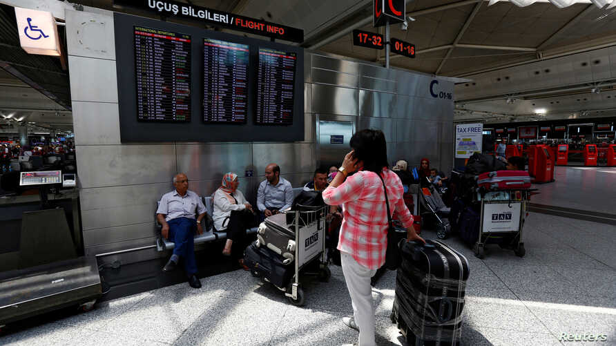 Passengers wait for their flights at Turkey's largest airport, Istanbul Ataturk, following yesterday's blast, June 29, 2016.