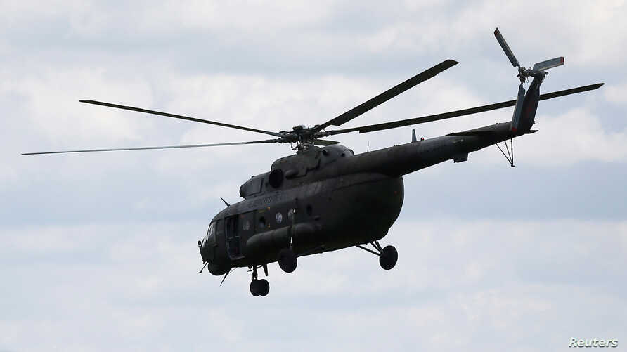 A Russian-made MI-17 helicopter of the Colombian army is seen flying in Meta, Colombia Jan. 14, 2018.