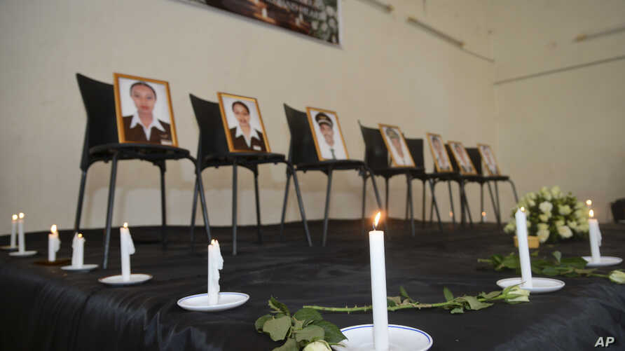 Framed photographs of seven crew members are displayed at a memorial service held by an association of Ethiopian airline pilots, in Addis Ababa, Ethiopia, March 11, 2019.