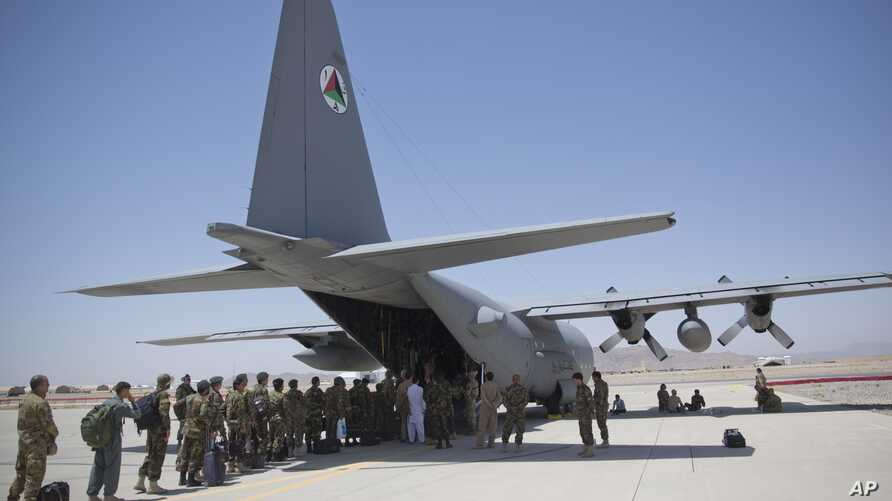 FILE - Afghan National Army soldiers line up to get into a C-130 Hercules at Kandahar Air Base in Kandahar, Afghanistan, Aug. 18, 2015.