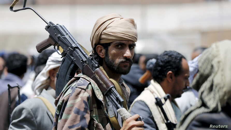 A tribesman loyal to the Houthi movement carries his rifle as he attends a gathering in Yemen's capital Sanaa, April 17, 2016.