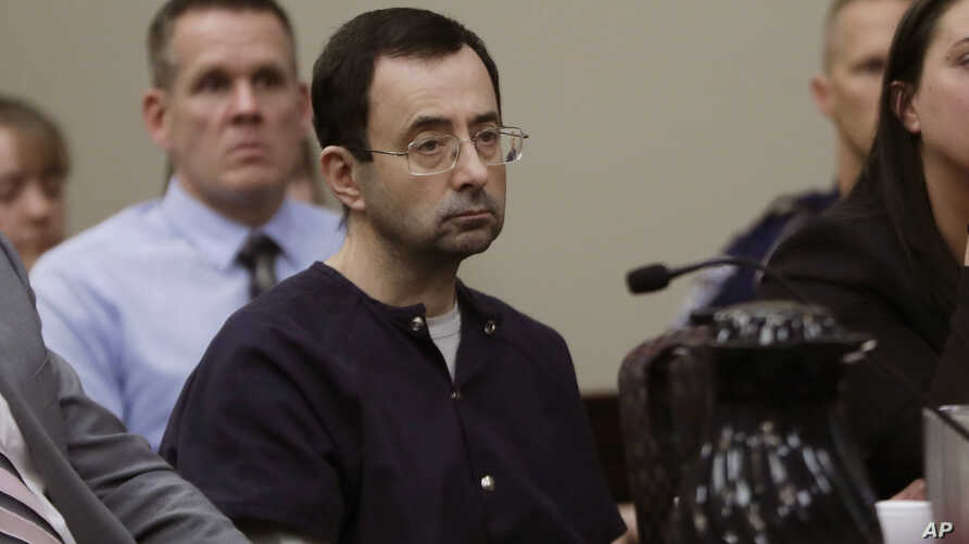 FILE - Larry Nassar sits during his sentencing hearing in Lansing, Mich. Nassar, a 54-year-old former doctor for USA Gymnastics and member of Michigan State's sports medicine staff, admitted to molesting athletes while he was supposedly treating them
