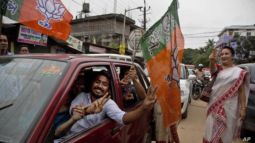 Bharatiya Janata Party (BJP) supporters celebrate their party's win in state assembly elections in Gauhati, India, May 19, 2016. India's ruling Hindu nationalist party also made dramatic gains in elections in the eastern state of Assam.