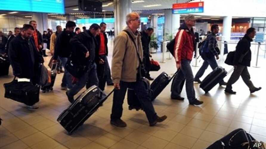 Bulgarian planes carrying Bulgarians and other foreigners - Croats, Serbs and Macedonians, Romanians, Chinese and South Koreans - arrive in Sofia, from Tripoli, Libya, Feb. 23, 2011
