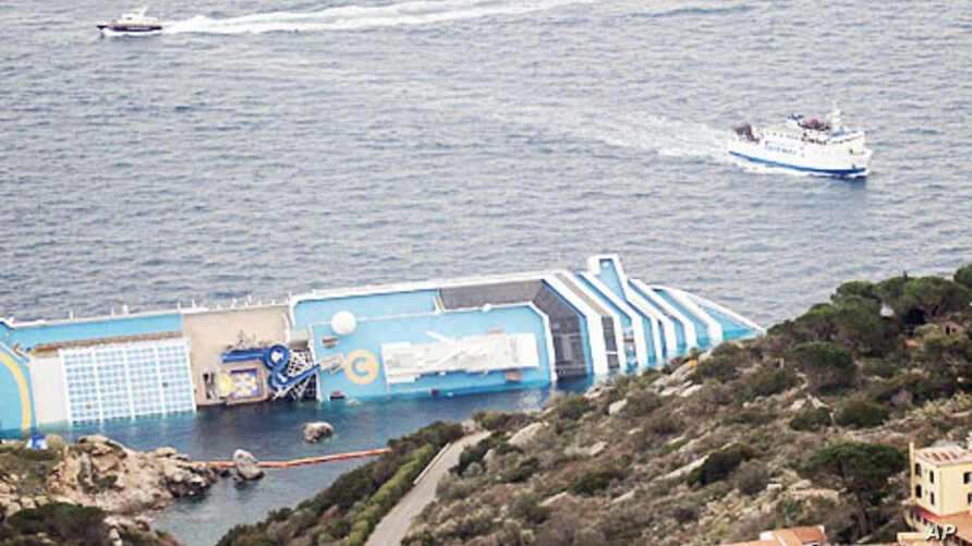 This picture shows a view of the cruise liner Costa Concordia aground in front of the harbor of the Isola del Giglio (Giglio island), January 18, 2012.