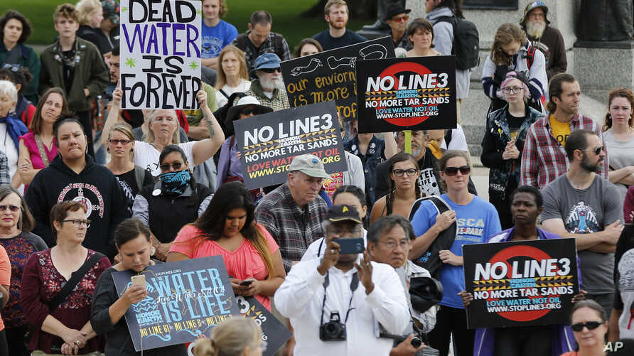 Tribal and environmental groups opposed to the proposed Enbridge Line 3 project rally, Sept. 28, 2017 at the State Capitol in St. Paul, to express concerns about the project's risks to Minnesota's clean water and wildlife.