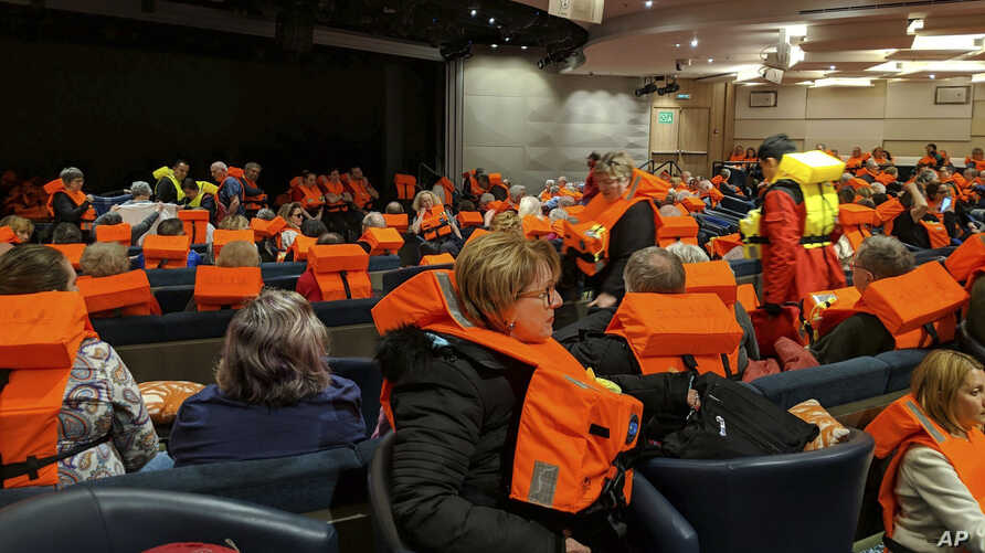This photo provided by Michal Stewart shows passengers on board the Viking Sky, waiting to be evacuated, off the coast of Norway, March 23, 2019.