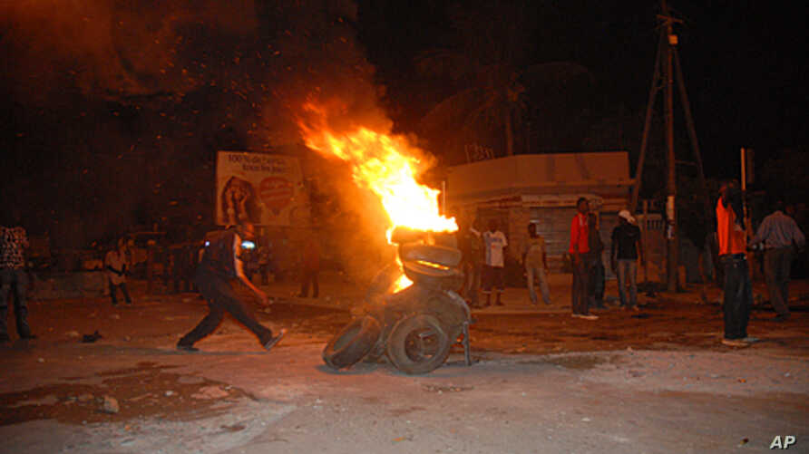 Protesters burn tires in a street after Senegal's highest court ruled that the country's increasingly frail President Abdoulaye Wade, 85, could run for a third term in next month's presidential election, in Dakar, Senegal, January 27, 2012.