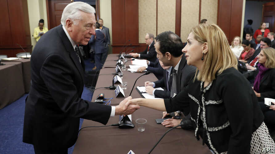 House Minority Whip Steny Hoyer of Maryland, left, greets Farah Al Khafaji, a former Iraqi interpreter for the U.S. military, on Capitol Hill in Washington before a House Democratic forum on President Donald Trump's executive order on immigration, Fe