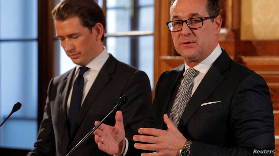 People's Party leader Sebastian Kurz, left, and Freedom Party leader Heinz-Christian Strache speak at a news conference after coalition talks in Vienna, Austria, Nov. 3, 2017.