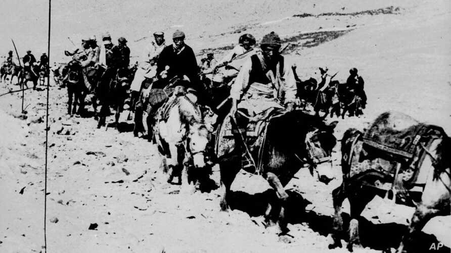 In this March 21, 1959 file photo the Dalai Lama and his escape party is shown on the fourth day of their flight to freedom as they cross the Zsagola pass, in Southern Tibet, while being pursued by Chinese military forces, after fleeing Lhasa. The 23