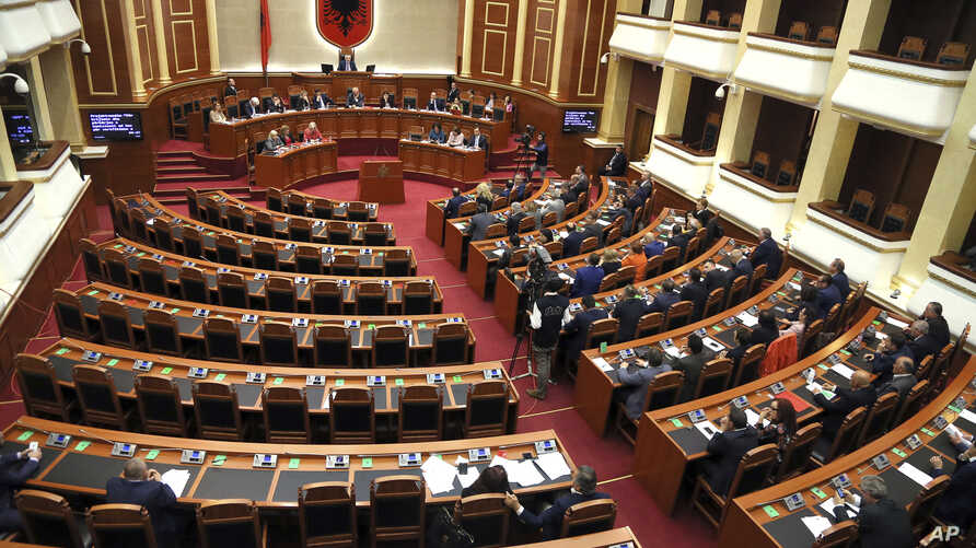 Albanian Lawmakers take part in an parliament session as the seats of the main opposition Democratic party (L) are empty, in Tirana, April 11, 2017.