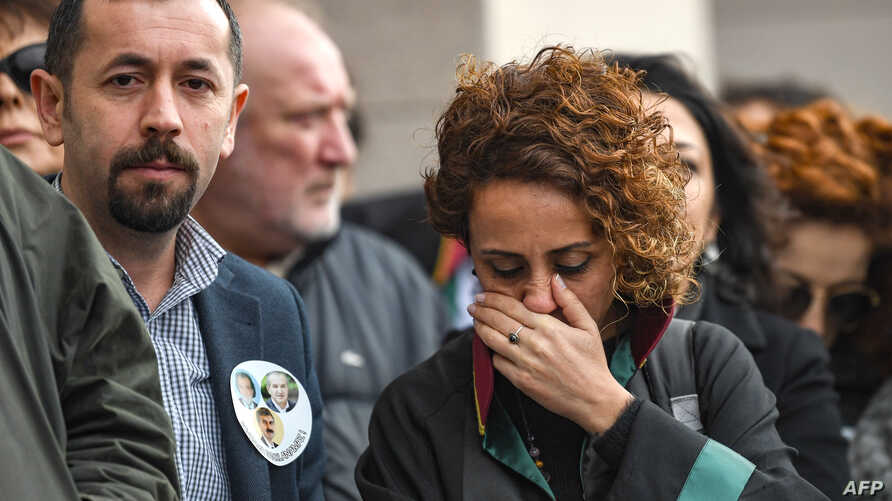 Lawyers and opposition MPs gather outside the Caglayan courthouse, Feb. 21, 2019, in Istanbul, to protest against the upholding by an appeals court of the jail sentences against opposition journalists in a long-running case targeting the Cumhuriyet n