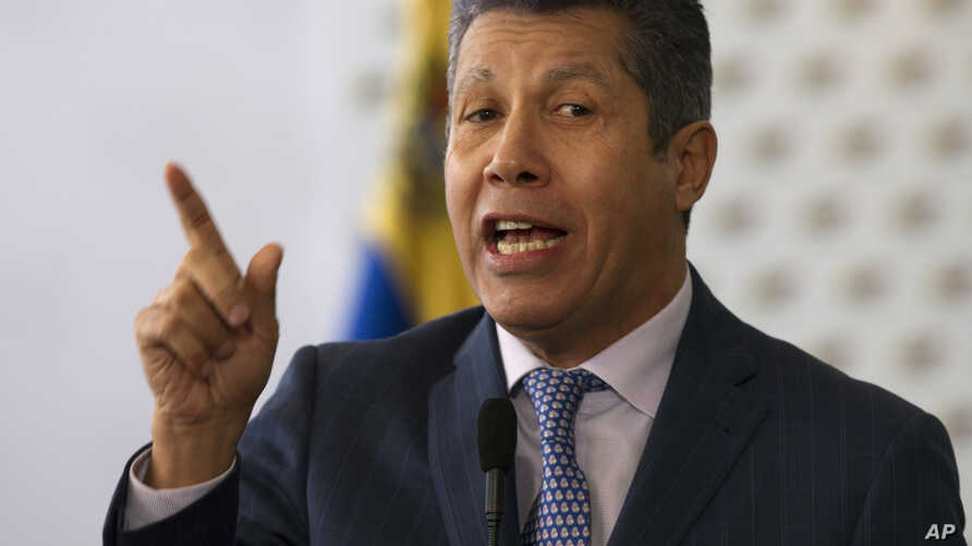 Henri Falcon, a former governor and former aide to the late President Hugo Chavez, speaks to the press after signing a document that states electoral guarantees for the upcoming presidential election at the National Electoral Council in Caracas, Vene...