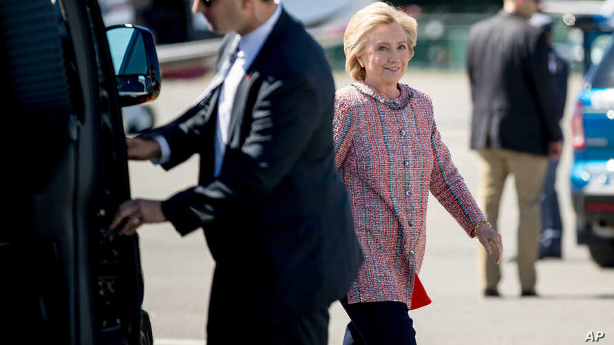 Democratic presidential candidate Hillary Clinton arrives to board her campaign plane at Westchester County Airport, in White Plains, Sept. 15, 2016, to travel to Greensboro, N.C. for a rally.