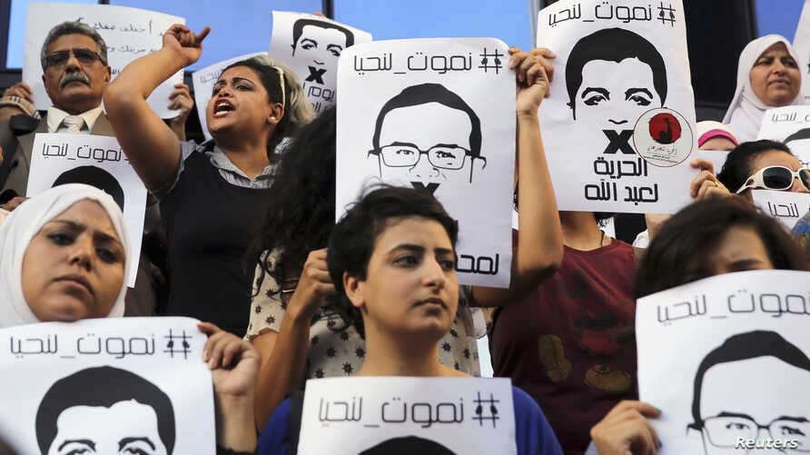 FILE - Protesters rally in support of three detained Al Jazeera journalists in front of the Press Syndicate in Cairo, Egypt, June 1, 2014.