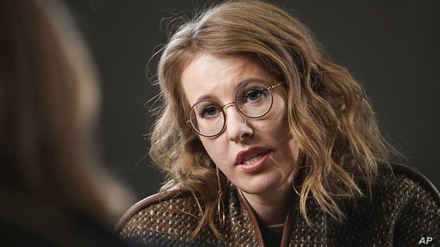 Russian celebrity TV host Ksenia Sobchak, who is challenging Russian President Vladimir Putin in the March 18 presidential election, speaks during an interview with the Associated Press in Moscow, Feb. 1, 2018.