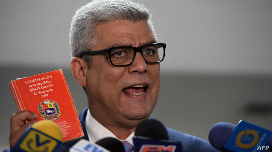 The second vice president of Venezuela's National Assembly, Alfonso Marquina, accompanied by opposition deputies of the Primero Justicia party, speaks at a news conference in Caracas, Feb. 23, 2018. The Venezuelan opposition is opposed to President N