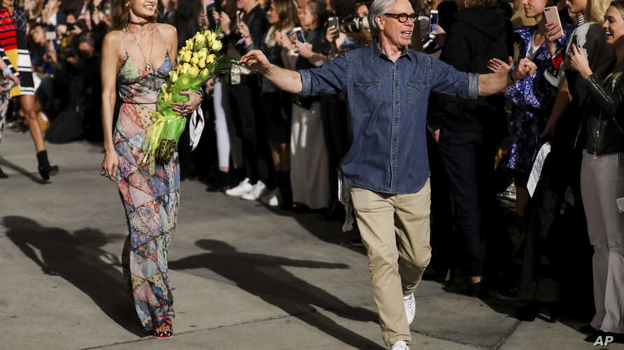 Gigi Hadid, left, and Tommy Hilfiger walk the runway at the Tommy Hilfiger TommyxGigi Runway Show at Venice Beach on Feb. 8, 2017 in Los Angeles.