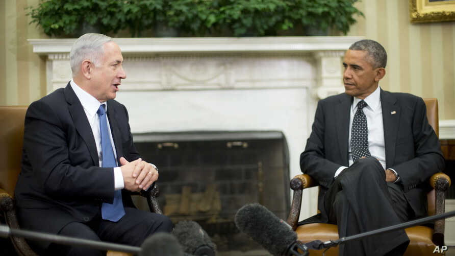 President Barack Obama meets with Israeli Prime Minister Benjamin Netanyahu in the Oval Office of the White House in Washington, Wednesday, Oct. 1, 2014.