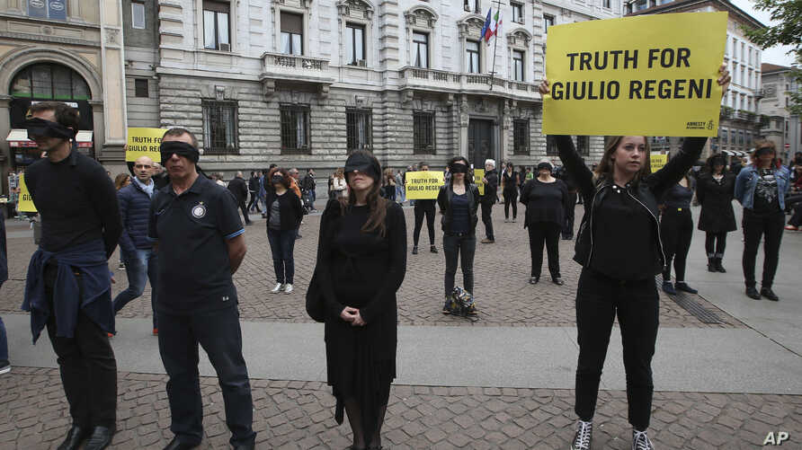 FILE - Amnesty International activists stage a flash mob asking for truth on the death of Italian student Guido Regeni, in front of Milan's city hall, Italy, April 24, 2016.