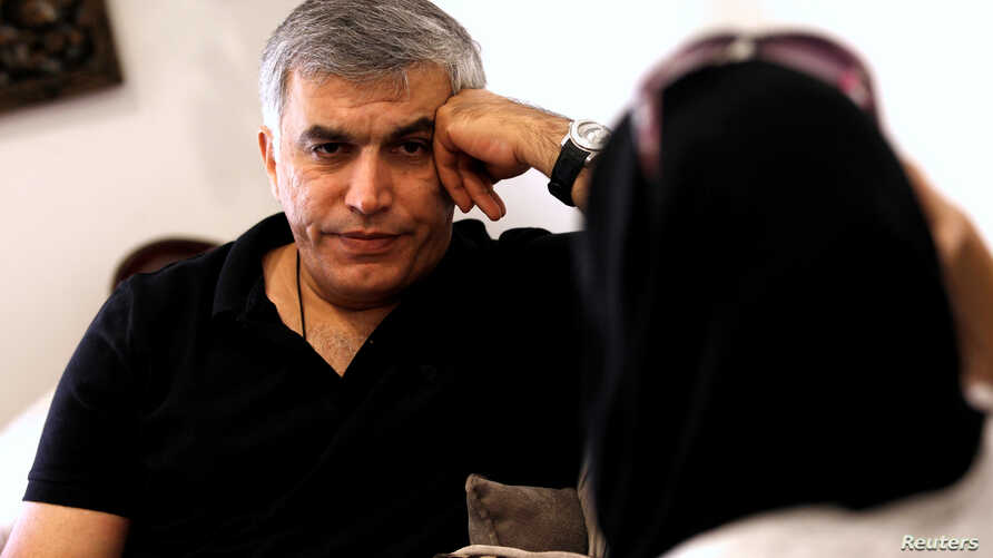 Human rights activists, Zainab al-Khawaja and Nabeel Rajab (L) talk during their meeting with activists after al-Khawaja's release from prison, Manama, Bahrain, June 3, 2016.