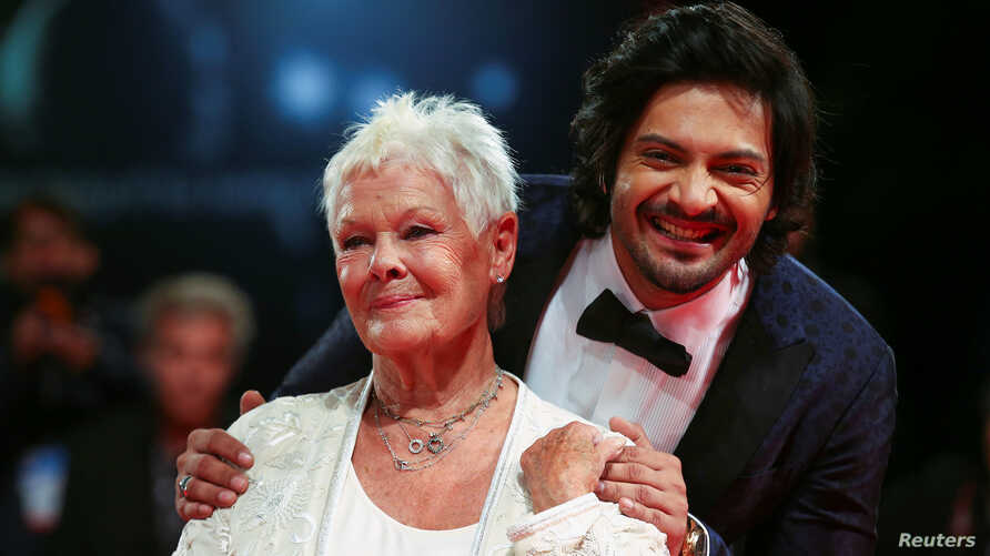 """Actors Ali Fazal and Judi Dench pose during a red carpet for the movie """"Victoria and Abdul"""" at the 74th Venice Film Festival in Venice, Italy, Sept. 3, 2017."""