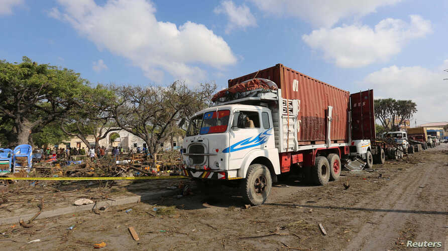 Trailers are parked outside a police cordon after a suicide car bomb went off at the entrance of Somalia's biggest port in its capital, Mogadishu, Dec. 11, 2016.
