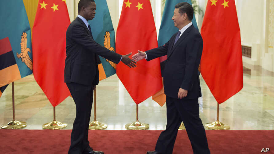 FILE - Zambia's President Edgar Lungu, left, shakes hands with China's President Xi Jinping, prior to their bilateral meeting at the Great Hall of the People, in Beijing, China, Sept. 1, 2018.